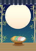Korean traditional rice cakes(Songpyeon)on bamboo and full moon night sky background