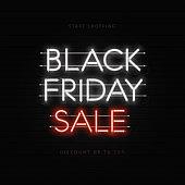 Black Friday sale neon banner, poster, sign. Dark web banner with neonon brick wall
