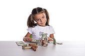Girl Counting Piggy Bank Savings