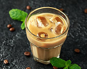 iced caramel coffee in a glass with cold milk. Summer drink