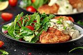 Chicken steak in Breadcrumbs with mushrooms and vegetables