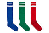 three pairs of colored football leggings or socks, in an upright position, on a white background