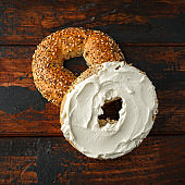 Bagels sandwich with cream cheese on wooden table