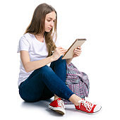 Woman sitting writing in notepad with pen backpack