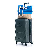 Summer holidays, vacation and travel concept. Suitcase, luggage with beach bag