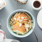 Healthy oatmeal with sliced apple and almonds