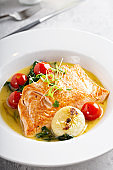 Poached or roasted salmon with vegetables