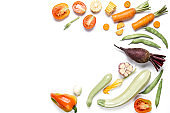 Creative layout made of haricot, tomatoes, pepper, corn, onion, red beet, carrot, zucchinion white background . Flat lay, top view, copy space. Healthy eating concept.