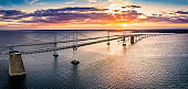 Aerial view of Chesapeake Bay Bridge at sunset.