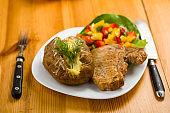roasted pork chop and potatoes with stuffed skin