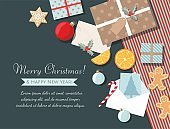 Holiday christmas background with gifts, cookies, greeting card and christmas ball. Top view.