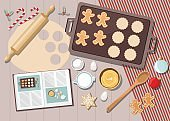 Bakery background with ingredients for cooking christmas baking. Sugar, eggs and spices on kitchen table,top view.