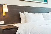Beautiful luxury comfortable white pillow and blanket on bed