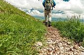 A man hiking on a rocky Mountain