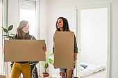 Lesbian couple moving into a new apartment