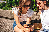Lesbian couple looking at mobile phone