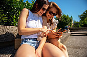 Happy LGBT Couple Looking at Mobile phone