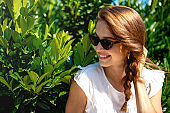 Young woman with sunglasses in the Park