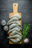 Raw tiger shrimps with dill and garlic.