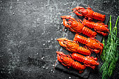 Fragrant boiled crayfish on a stone Board with dill.