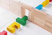 Colorful wooden shapes on white background. The concept of selecting, change, transformation, evolution.