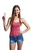 Young smiling girl pointing her finger up