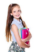 Portrait of cute smiling happy little school girl child teenager holding the books isolated