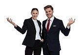 couple in business suits questioning with hands gesture
