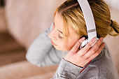Beautiful young woman listening to the music headphones enjoy at home on holiday relax