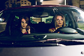 two women females in the car driving at night friends mother and daughter sisters travel journey road trip
