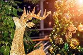 Christmas tree and Christmas reindeer  inside during Christmas Day.