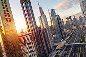 Aerial view of cityscape at sunrise in Dubai UAE.