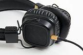 black headphones closeup on white background