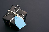 Gift for him Top view of stylish black gift with small bow