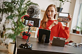 Beauty tips. Young attractive woman showing a makeup palette on camera while recording video review for her beauty blog