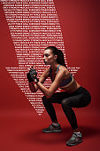 Sport is the way of her life. Sportswomanstanding over red background, stretching her body. Graphic drawing.