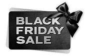 Black Friday sale silver text write on black gift card with black ribbon bow