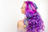 Stylish fashionable young woman with bright hair coloring, Magenta and purple.