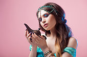 Prince Jasmine, a young woman in the image of an Eastern fairy Princess. The girl calls gin and makes a wish.