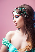 Prince Jasmine, a young woman in the image of an Eastern fairy Princess.