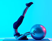 woman exercsing fitness pilates exercices isolated