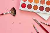 Set for eye makeup, eyeshadow in a palette and brush for a good application