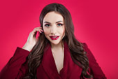 Attractive brunette one tone look. Portrait of Surprised attractive young woman