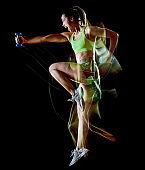 woman exercising fitness exercises isolated black background lightpainting effect