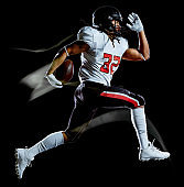 american football player man isolated black background light painting