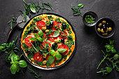 Pizza. Traditional italian pizza with green basil pesto sauce