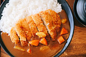 Curry rice with fried pork tonkatsu Japanese food on wooden table