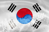 South Korea flag, stock market, exchange economy and Trade, oil production, container ship in export and import business and logistics.