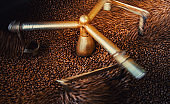 Arabica coffee beans roasted in cooling down after roasted machine, Close-up