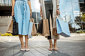 Women with shopping bags near the mall outdoors